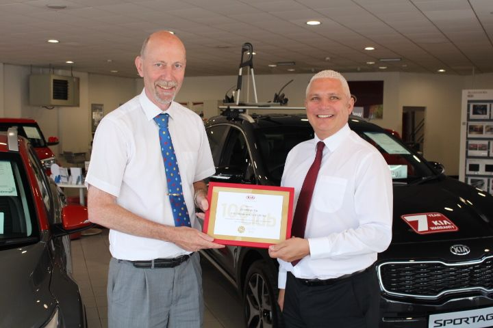 Downeys Kia presented with Kia 100 club award
